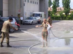 Army hose down muddy girl