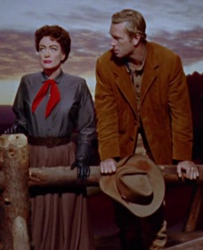Vienna (Joan Crawford) and Johnny Guitar (Sterling ) share a tense moment.