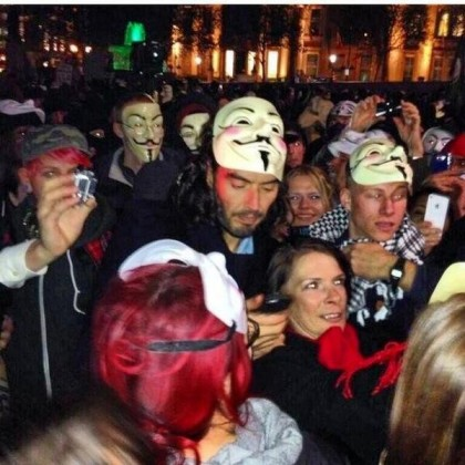 Not one to stay anonymous, Russell Brand mixes with the Occupy London protesters.